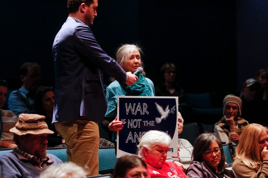 Anita Owen asks a question about the drone strike in Iran during a town hall with Sen. Ron Wyden at Chemeketa Community College in Salem on Jan. 3, 2020.