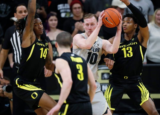 Colorado forward Alexander Strating, back center, is trapped with the ball by Oregon forwards C.J. Walker, back left, and Chandler Lawson, back right, and guard Payton Pritchard in the first half of an NCAA college basketball game Thursday, Jan. 2, 2020, in Boulder, Colo.