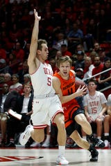 Oregon State guard Zach Reichle (11) drives to the basket as Utah guard Jaxon Brenchley (5) defends in the first half during an NCAA college basketball game Thursday, Jan. 2, 2020, in Salt Lake City.