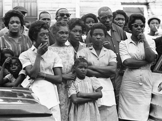 Mourners in Birmingham, Alabama, stand outside funeral services for Carol Robertson, one of four girls killed in the 1963 terror bombing by the Ku Klux Klan.