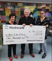 Local Financial Representative Tommy Wood, center, with WoodmenLife Chapter 66 in San Angelo, presents a check for $1,000 to Meals for the Elderly President and CEO Charlyn Ocker, left, and Marketing and Event Director Dannielle Dunagan, right.