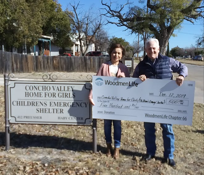 WoodmenLife's Chapter 66 Financial Representative Tommy Wood, right, recently presented a $500 check to Executive Director Tina Medrano with theConcho Valley Home For Girls and Children's Emergency Shelter in San Angelo.