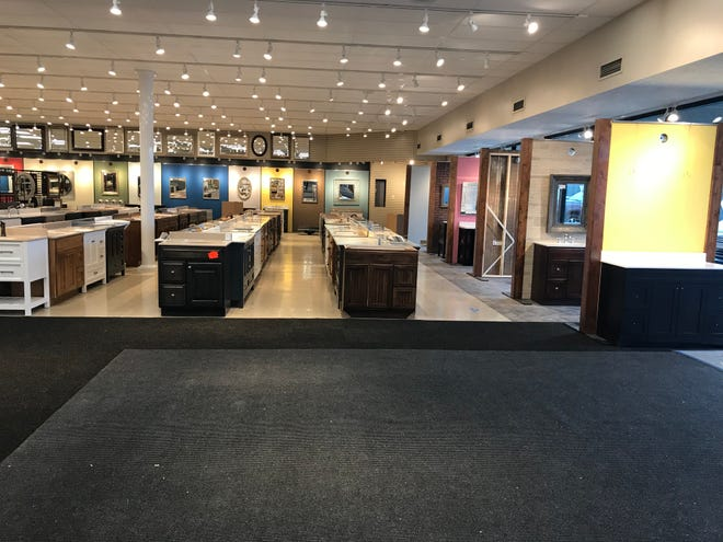 New floors and new product fill the Handy Man Home Remodeling Center, which opened last week. The store is planning a grand opening event for Jan. 18, with deals for customers as part of a scratch-and-dent sale.