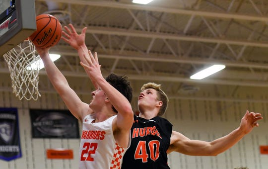 Derick Siemonsma of Huron blocks a shot by Ganin Thompson of Washington on Thursday, Jan. 2, at Washington High School in Sioux Falls.