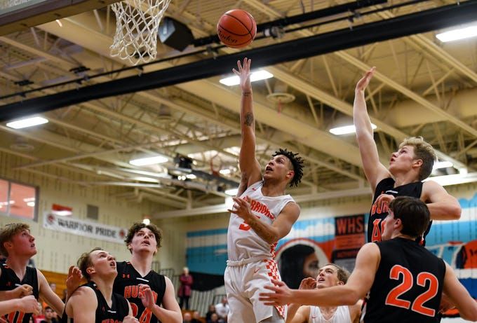 Eli Williams of Washington makes a basket in a game against Huron on Thursday, Jan. 2, at Washington High School in Sioux Falls.