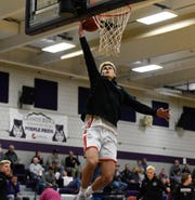 ROCORI senior Andrew Anderson goes up for a layup in warmups Thursday, Jan. 2, 2020, at Albany High School.