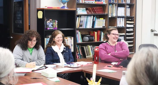 Sauk Rapids-Rice Adult Education staff Renee St. John, Kali Pelham and Kristen Kolb learn about the Portrait of a Graduate process during an input session Dec. 4, 2019.