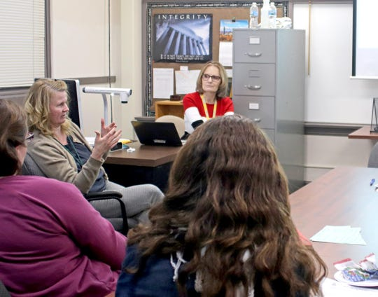 Jenny Bushman, Sauk Rapids-Rice Director of Teaching and Learning (left) speaks to staff members about the Portrait of a Graduate project at an input session Dec. 4, 2019