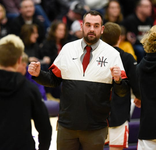 ROCORI head coach Levi Peterson fist bumps his players Thursday, Jan. 2, 2019, at Albany High School.