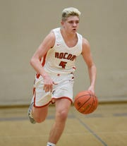 ROCORI junior Tucker Haakonson dribbles the ball up the court Thursday, Jan. 2, 2020, at Albany High School.