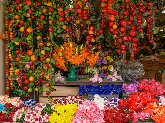 A photograph captures the colorful flowers of a shop at the Downtown Mercado.