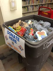 People who owe El Paso Library fines can reduce their debt with a good deed: donating canned goods.