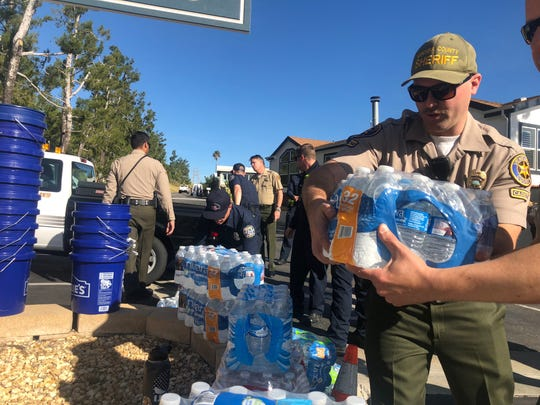 Officials hand out cases of bottled water at Vallecito mobile home park on Jan. 2, 2019. Residents of the senior community in Newbury Park went without running water for multiple days.