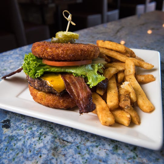 Blu Alehouse, at the Palisades Center, offers a host of American favorites like this burger and fries.