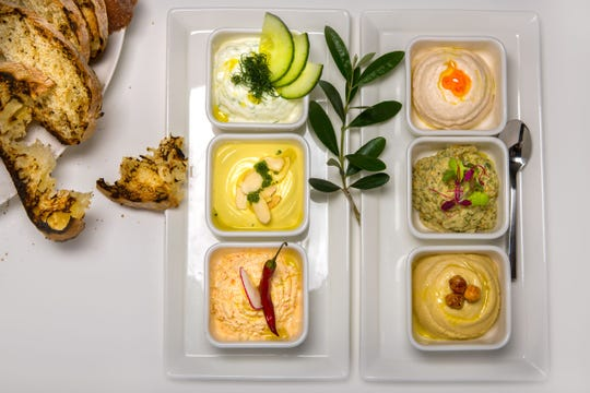 An array of dips at Kyma Flatiron. The NYC restaurant is one of many participating in NYC's Restaurant Week.