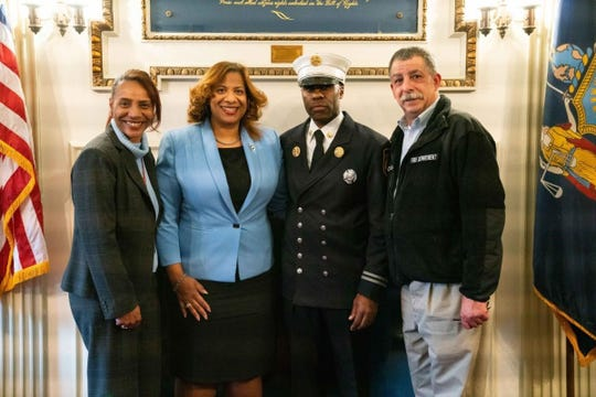 "From left to right, Mount Vernon Deputy Fire Commissioner Deborah Norman, Mayor Shawyn Patterson-Howard, newly appointed Fire Chief Kim ""Robert"" Odindo and Fire Commissioner Teddy Beale"