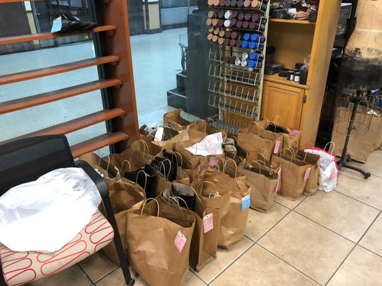 Shoes are in paper bags at Chillemi Shoe Repair Friday, Jan. 3, 2020, after flooding at the White Plains Mall from the previous week. The shoe shop was moving to a location Monday, Jan. 6, 2020.