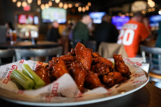 An order of wings sits in the bar area at Grotto Pizza's Pennsylvania Ave location in Wilmington. The restaurant was voted a top wing spot in the state by Delaware Online/News Journal readers.