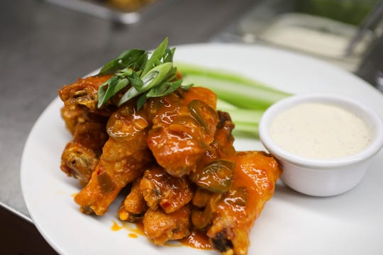 A plate of buffalo wings sit on the prep table at Two Stones Pub in Middletown on Wednesday, Jan. 1.