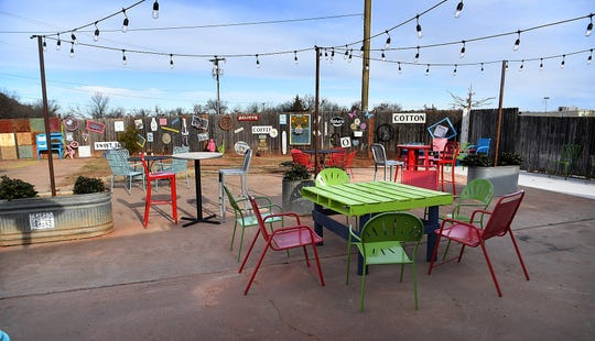 A large backyard patio with seating and an art wall help provide a relaxed atmosphere at the new Hobo Coffee and Ice Company on Seymour Highway.