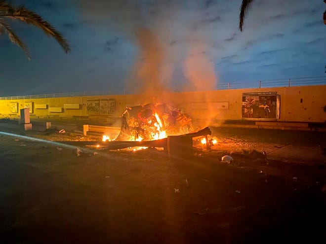 This photo released by the Iraqi Prime Minister Press Office shows a burning vehicle at the Baghdad International Airport following an airstrike in Baghdad, Iraq, early, Jan. 3, 2020. The Pentagon said Thursday that the U.S. military has killed Gen. Qasem Soleimani, the head of Iran's elite Quds Force, at the direction of President Donald Trump.