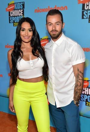 Nikki Bella and Artem Chigvintsev attend Nickelodeon Kids' Choice Sports 2019 at Barker Hangar on July 11, 2019 in Santa Monica, California.