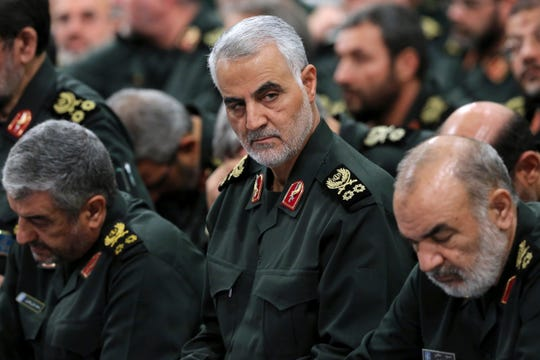 In this Sept. 18, 2016, file photo provided by an official website of the office of the Iranian supreme leader, Revolutionary Guard Gen. Qasem Soleimani, center, attends a meeting in Tehran, Iran. Iraqi TV and three Iraqi officials said Friday, Jan. 3, 2020, that Soleimani, the head of Iran's elite Quds Force, has been killed in an airstrike at Baghdad's international airport.