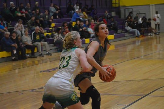 Hicks sophomore Lauren Quinn (5) goes for 2 against Plainview's Abigail Pippen Friday.