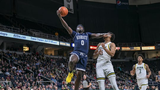 Monmouth's Ray Salnave drives to the basket against Siena on Friday night at the Times Union Arena in Albany, New York. Salnave scored 20 points, but the Hawks lost, 75-72.