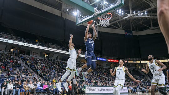 Monmouth's Deion Hammond (3) scores two of his game-high 23 points during the Hawks' 75-72 loss to Siena in Albany, New York on Friday night.