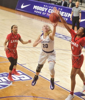 ACU's Breanna Wright (10) drives against Lamar's Briana Laidler (4) while Jadyn Pimentel (1) looks on during the first half of the  Southland  Conference game Saturday, Jan. 4, 2020, at Moody Coliseum.