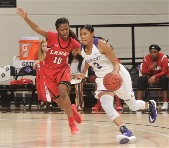 ACU's Dominique Golightly (3) tries to get around Lamar's Malay McQueen during the first half of the Southland Conference game Jan. 4 Moody Coliseum. ACU won the game 78-72.