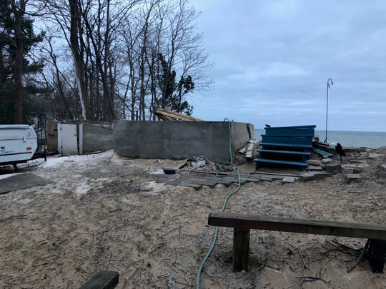 Patricia Gancer's Lake Michigan cottage once stood at the top of this sand bluff. Erosion caused it to collapse on Dec. 31, 2019.