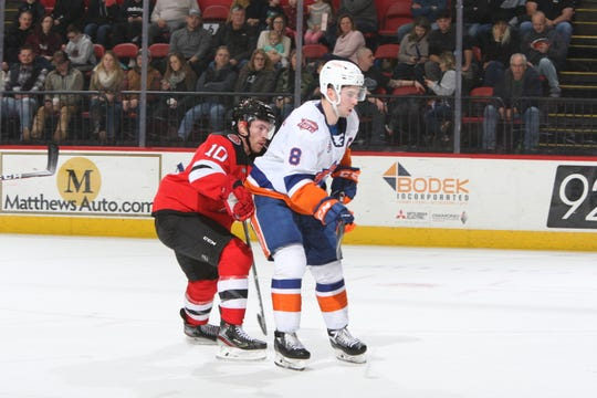 The Binghamton Devils' Ben Street, left, defends against the Bridgeport Sound Tigers' Kyle Burroughs during Friday's game at Floyd L. Maines Veterans Memorial Arena. Street scored in the B-Devils' 3-1 victory.