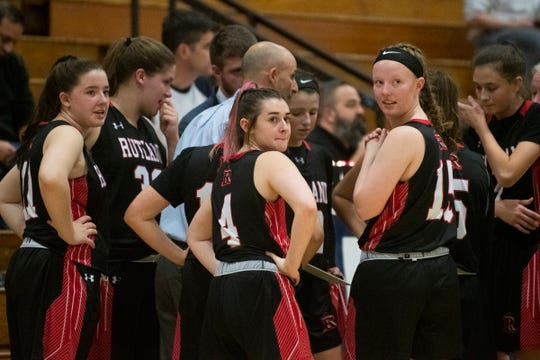 Rutland's Olivia Calvin (11), Megan Smith (4) and Anna Bower (15) look towards the stands during the girls basketball game between the Rutland Raiders and the Burlington Seahorses at Burlington High School on Friday night January 3, 2020 in Burlington, Vermont.