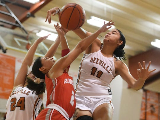 Beeville's Kamaria Gipson, right, reaches for the ball against Robstown, Friday, Jan. 3, 2020, in Beeville. Gipson is a senior on the team.