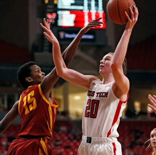 Texas Tech's Brittany Brewer (20) shoots the ball over Iowa State's Ines Nezerwa (15) during the conference game against Iowa State, Friday, Jan. 3, 2020, at United Supermarkets Arena in Lubbock, Texas. [Brad Tollefson/A-J Media]