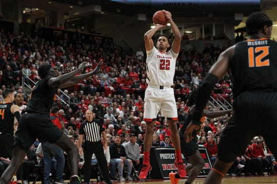 Jan 4, 2020; Lubbock, Texas, USA;  Texas Tech Red Raiders forward TJ Holyfield (22) shoots the ball over Oklahoma State Cowboys forward Yor Anei (14) in the first half at United Supermarkets Arena. Mandatory Credit: Michael C. Johnson-USA TODAY Sports