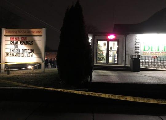 Police tape seals off the Shamrock Deli in Audubon on Friday night.