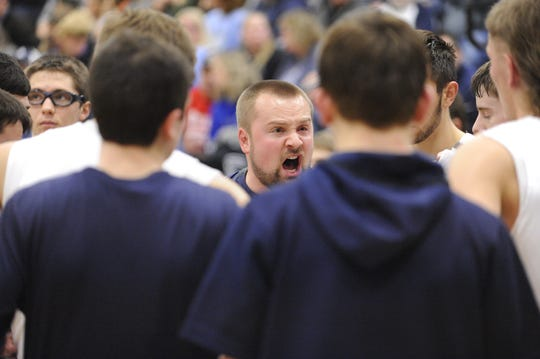 Adena head coach Kyle Bradley coaches team during a time out of a 56-38 loss to Unioto at Adena High School in Frankfort, Ohio on Friday Jan. 3, 2020.