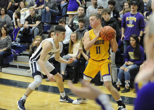 Unioto guard Isaac Little looks to get past Adena's Nate Trockmorton during a 56-38 win over Adena at Adena High School in Frankfort, Ohio on Friday Jan. 3, 2020.
