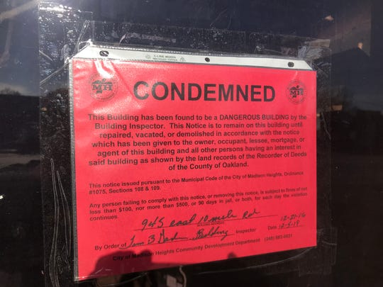 "In a photo shot Jan. 2, 2020, a ""Condemned"" sign dated 12/21/16 covers a door at former metal-plating shop, which Madison Heights officials sought for years to have demolished."