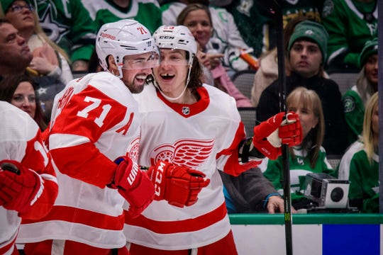 Detroit Red Wings center Dylan Larkin (71) and left wing Tyler Bertuzzi celebrates Larkin's goal against the Dallas Stars during the first period at the American Airlines Center on Friday, Jan. 3, 2020, in Dallas.