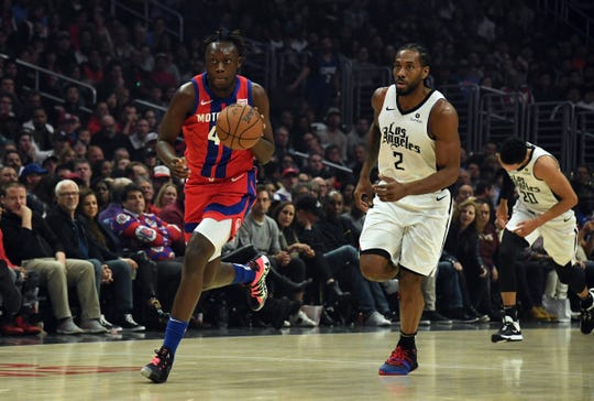 Sekou Doumbouya dribbles past Kawhi Leonard in the first quarter at Staples Center on Jan. 2.