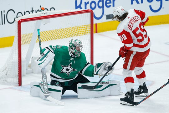 Dallas Stars goaltender Anton Khudobin (35) gloves a shot as Detroit Red Wings forward Tyler Bertuzzi (59) looks for a rebound during the second period of an NHL hockey game Friday, Jan. 3, 2020, in Dallas.