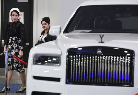 Meg McNamee and Pam Trammel look over a Rolls Royce while wondering around the Southeast Michigan Auto Show at Suburban Collection Showcase in Novi, on Jan. 4.