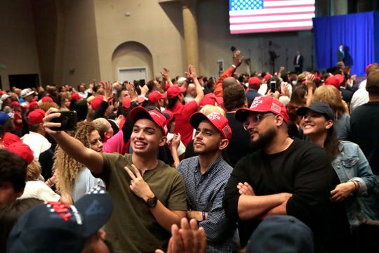 Supporters of President Donald Trump take a selfie during a rally for evangelical supporters at the King Jesus International Ministry church, Friday, Jan. 3, 2020, in Miami.