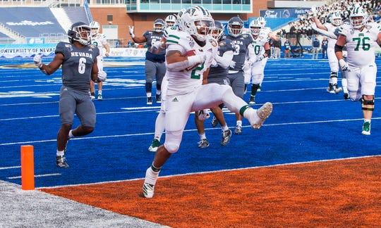 Ohio running back Julian Ross (2) high steps into the end zone, scoring the Bobcats' first touchdown.