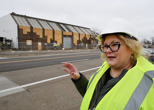 Michigan Department of Environment, Great Lakes and Energy Public Information Officer Jill Greenberg updates the situation at a condemned building containing toxic materials on 10 Mile Road in Madison Heights on January 4.