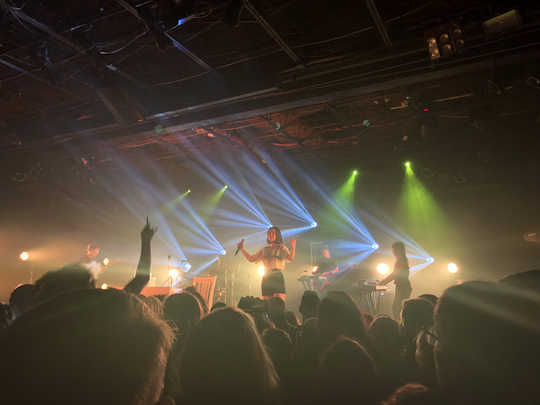 Mitski is framed by the colorful lights while she performs at The Moon in April 2019.